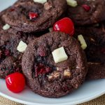 Black Forest Cookies: Soft and chewy chocolate cookies filled with creamy white chocolate chunks and sweet maraschino cherry pieces.
