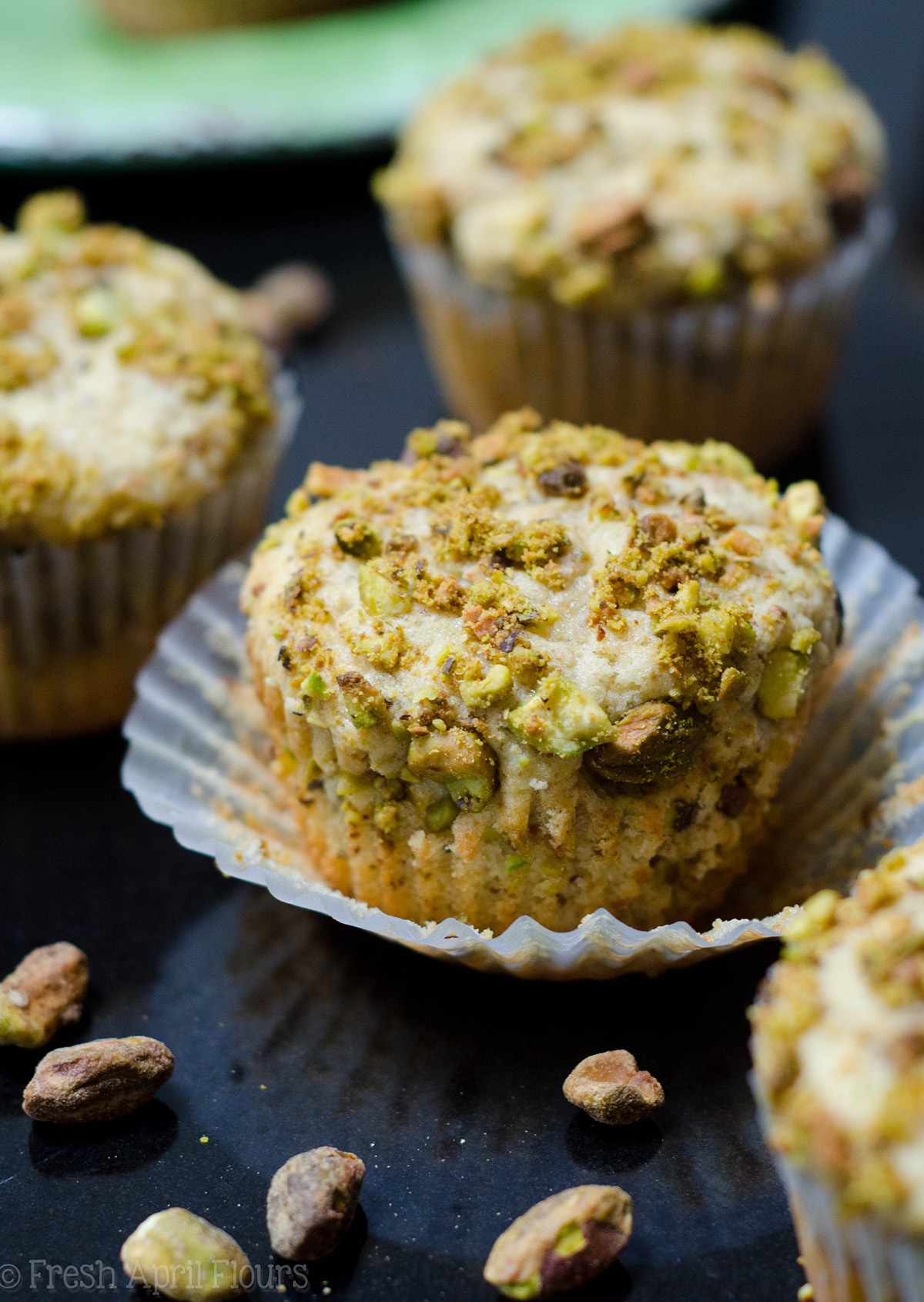 pistachio muffin unwrapped and sitting in its wrapper