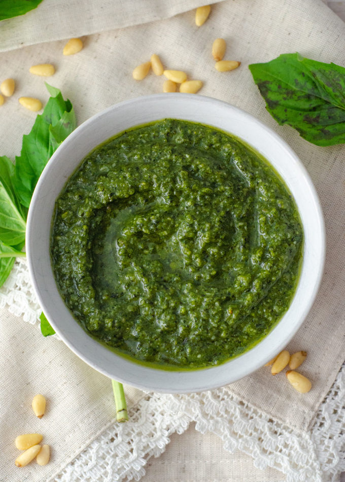 Homemade Pesto: Making your own herby, garlicy pesto at home is as easy as throwing FIVE ingredients into a food processor.