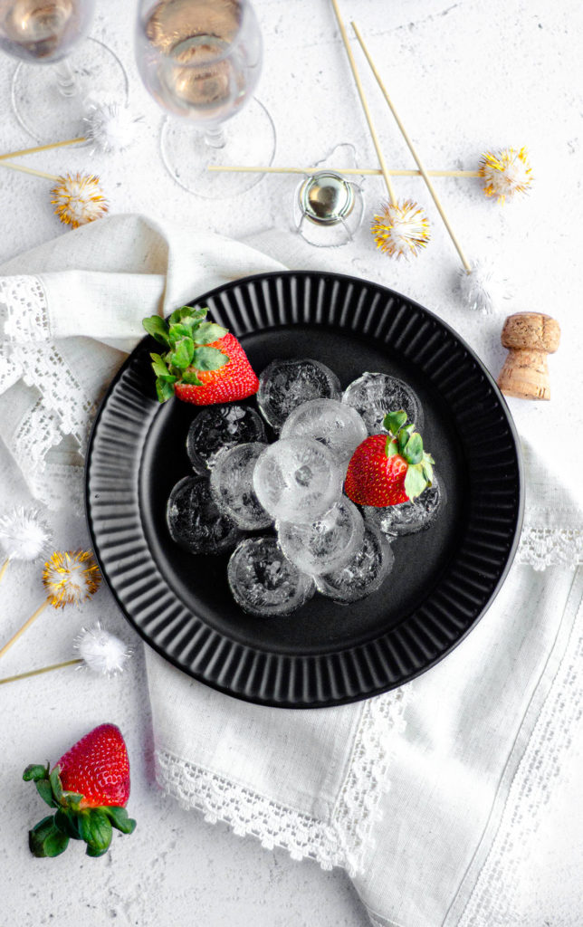 aerial photo of champagne jello shots on a plate