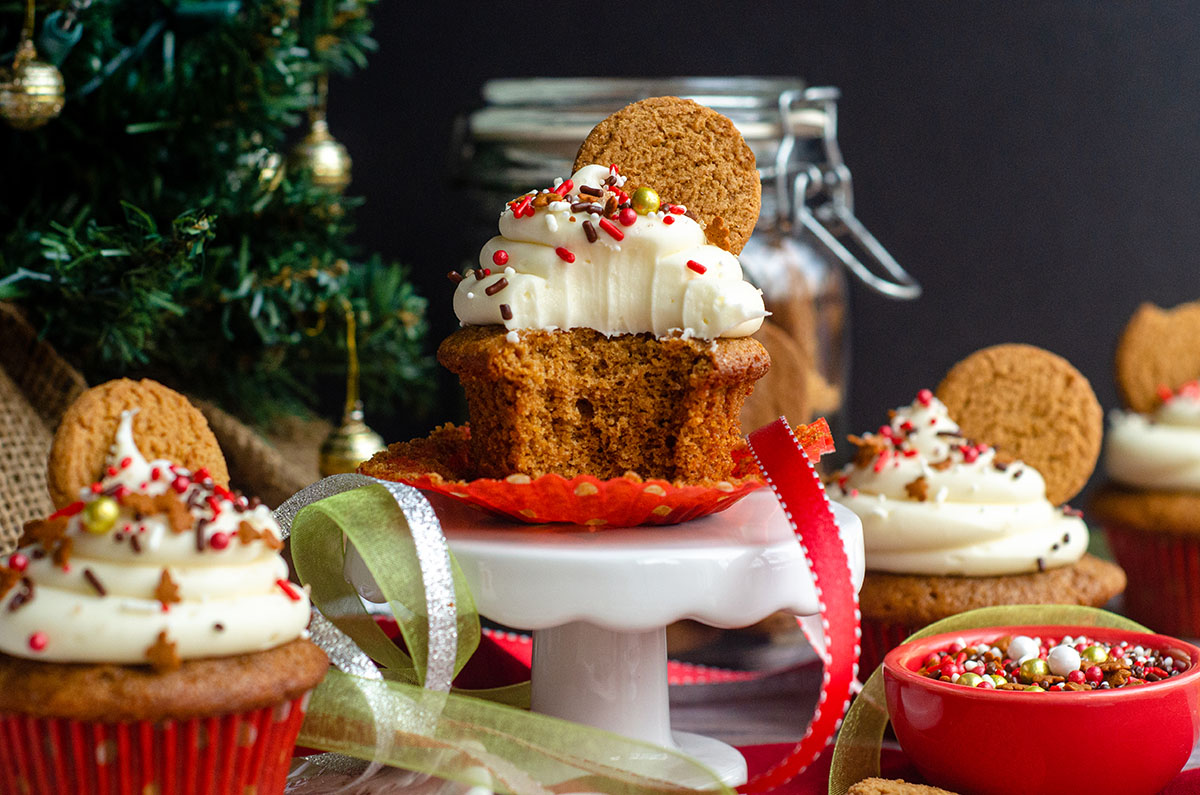 a gingerbread cupcake with a bite taken out of it