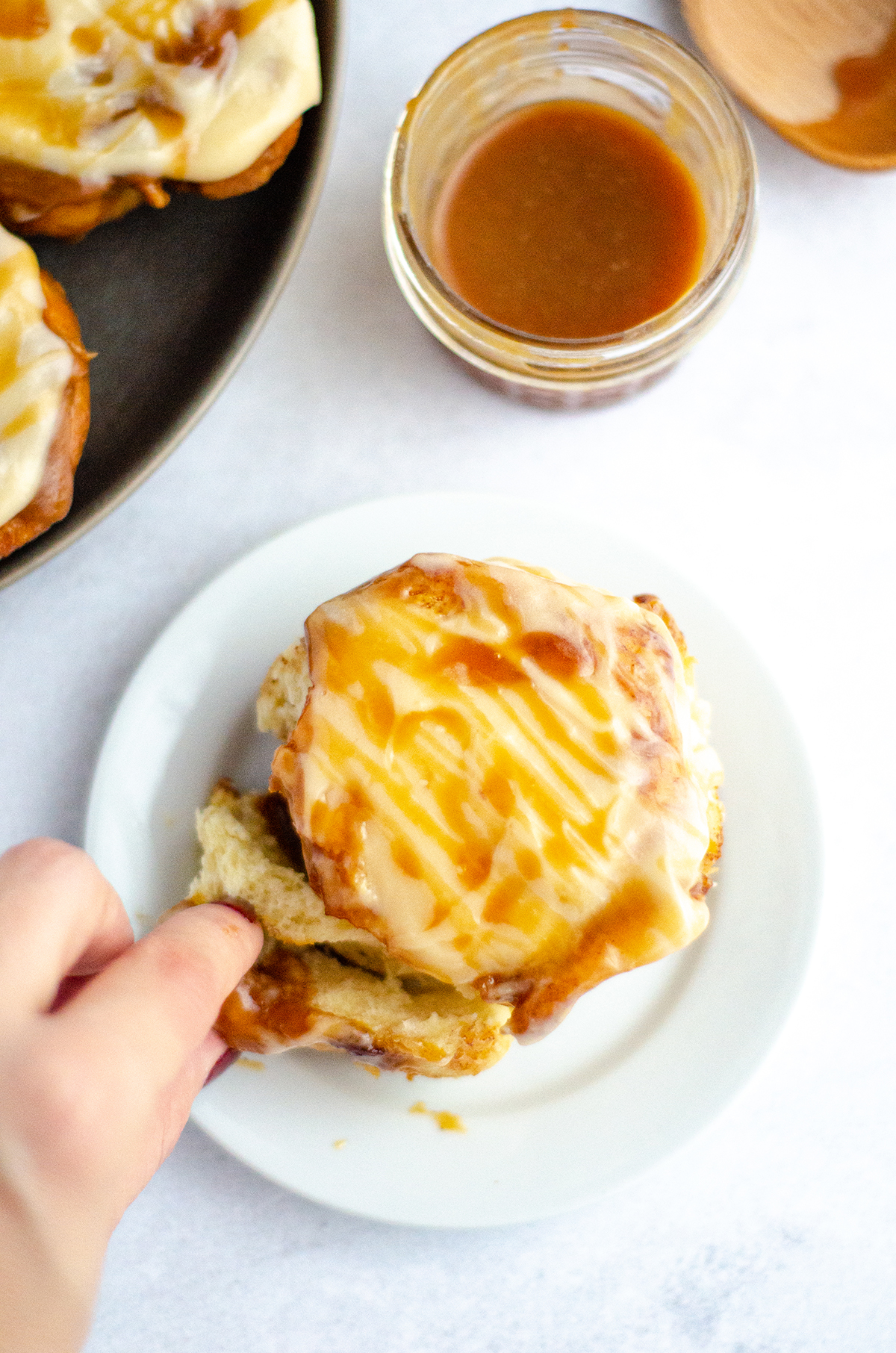 Easy small batch caramel cinnamon rolls drenched in salted caramel sauce and topped with a creamy salted caramel cream cheese frosting.
