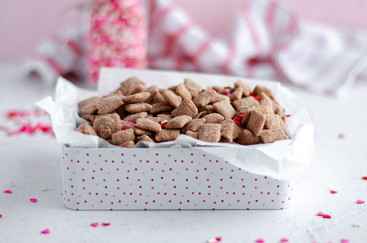 red velvet puppy chow in a treat box