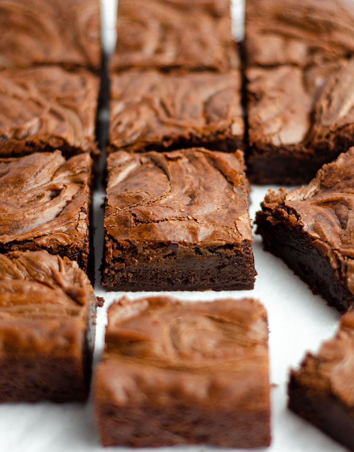 Fudgy Nutella Brownies: These seriously dense and fudgy Nutella brownies have Nutella blended right in the batter and swirled into the top. They are a chocolate lovers' dream!