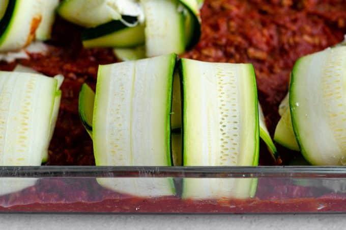 zucchini ravioli sitting in a baking dish ready to bake