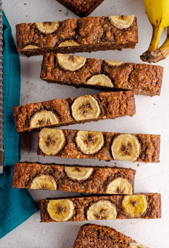 aerial photo of sliced almond flour banana bread with banana slices baked into the top
