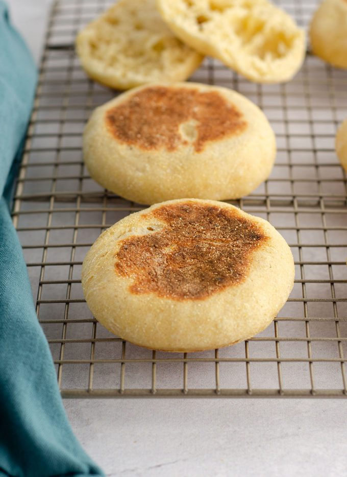sourdough english muffins on a cooling rack