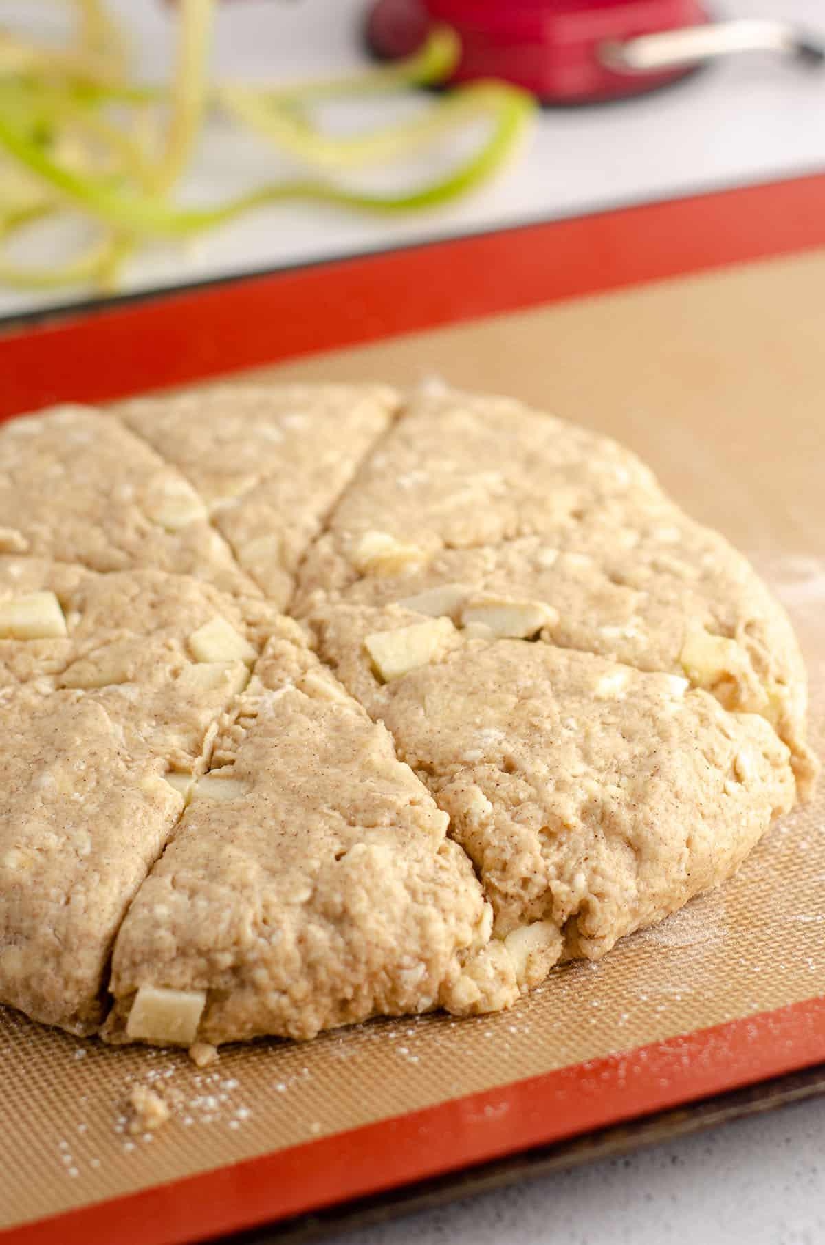 apple scones sitting on baking sheet ready to bake
