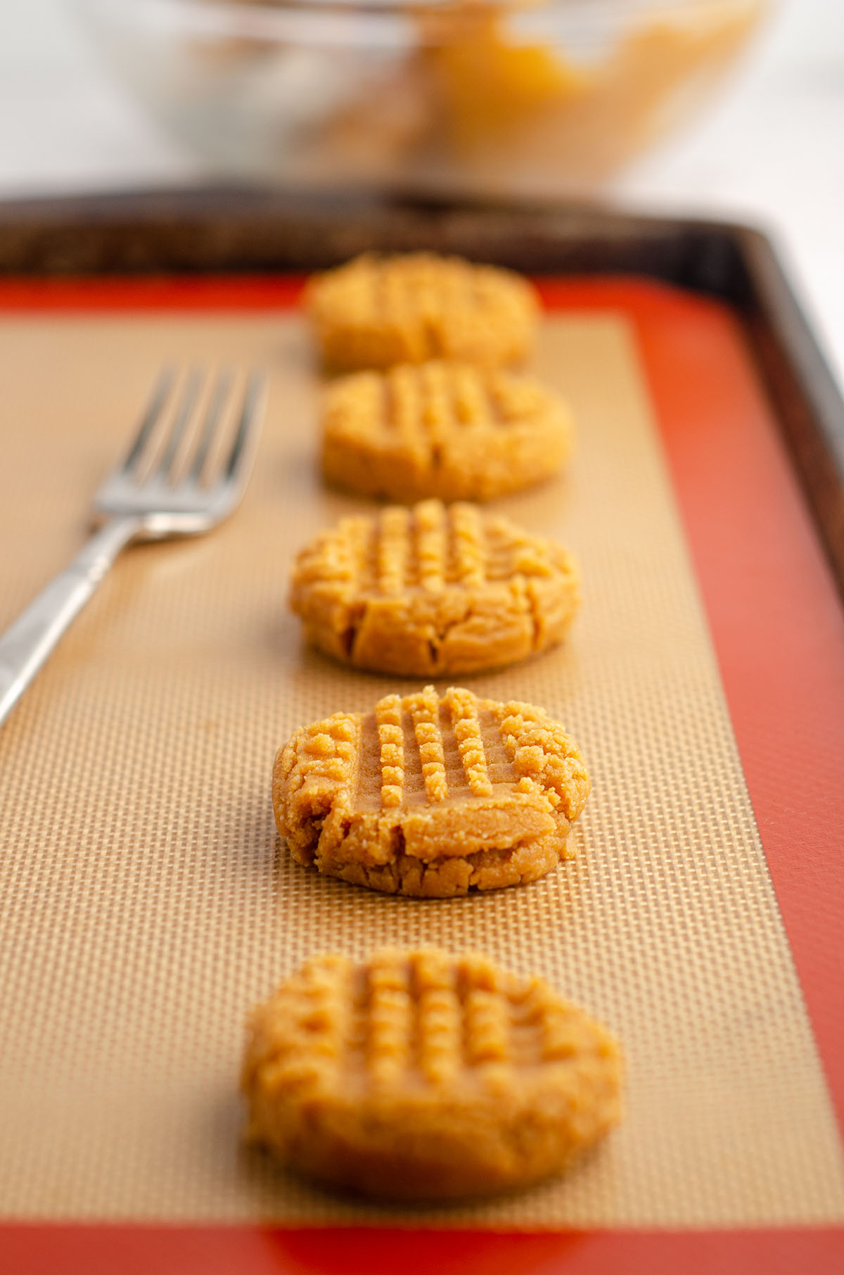 vegan and gluten-free peanut butter cookies on a baking sheet ready to bake