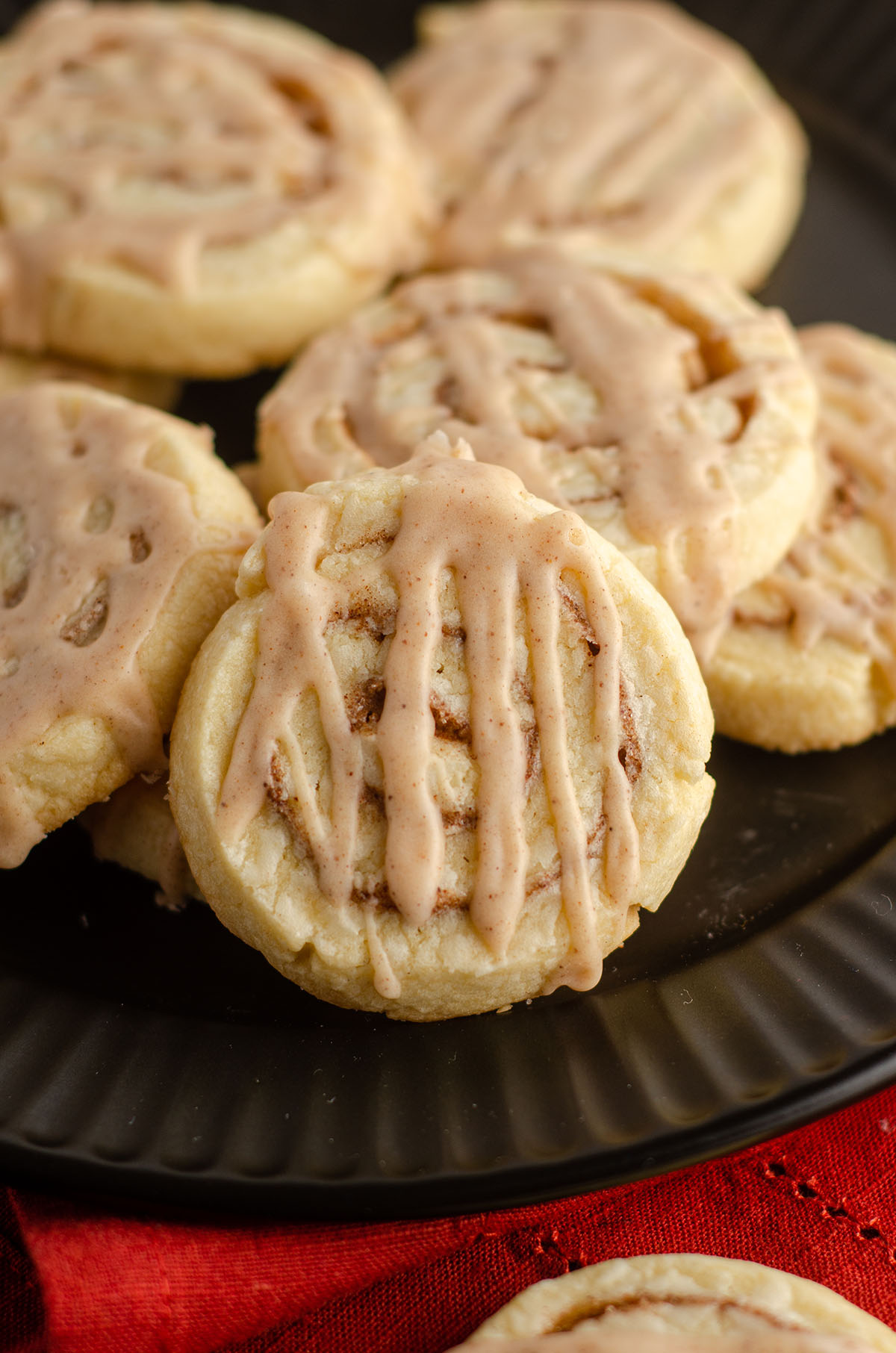 cinnamon pinwheel cookies sitting on a black plate