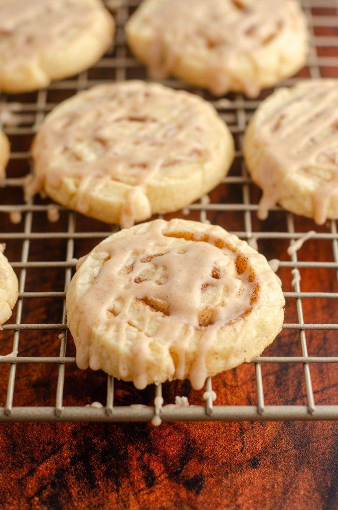 cinnamon pinwheel cookies on a wire cooling rack
