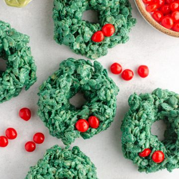 aerial photo of rice krispies wreaths with red candies scattered around