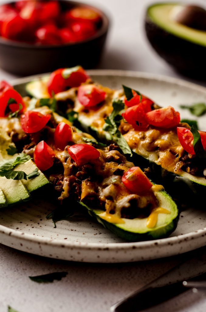 taco zucchini boats on a plate