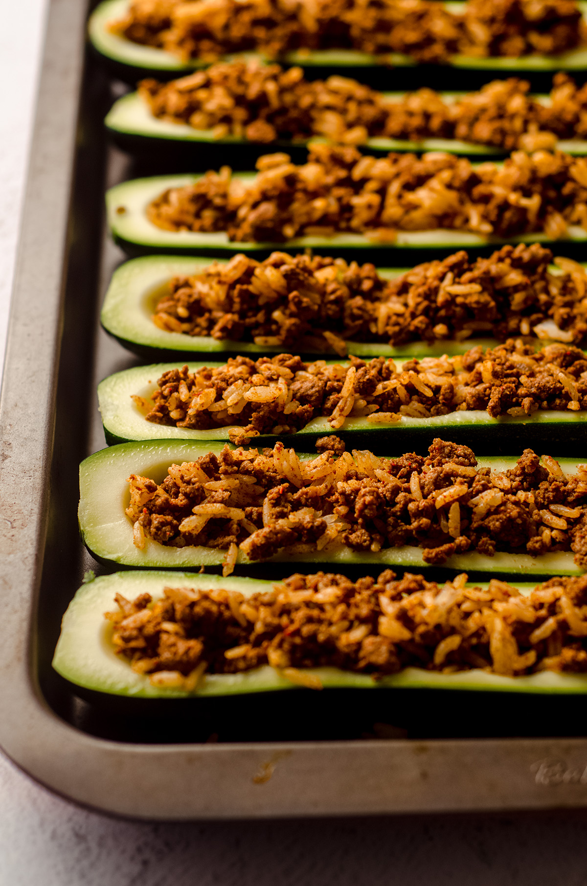 taco zucchini boats filled with meat and rice