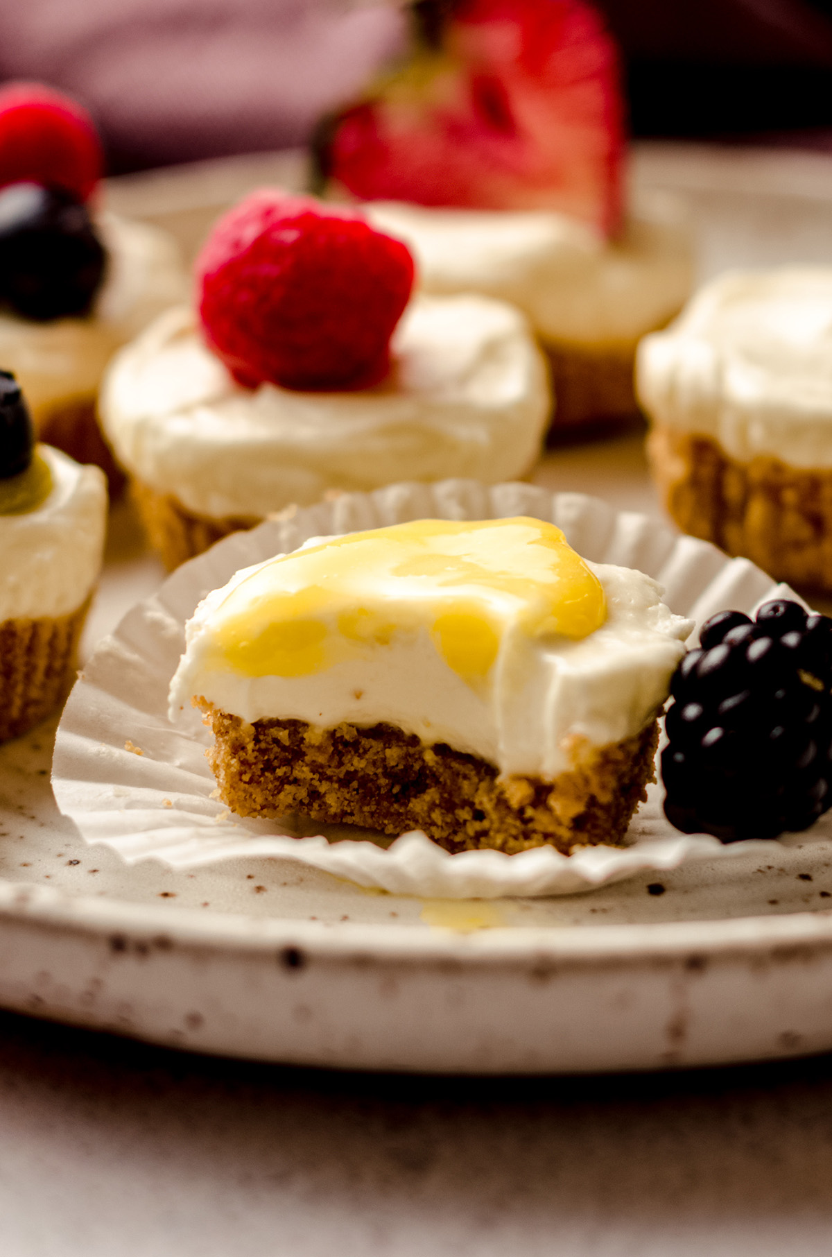 an unwrapped no bake cheesecake bite with lemon curd on top