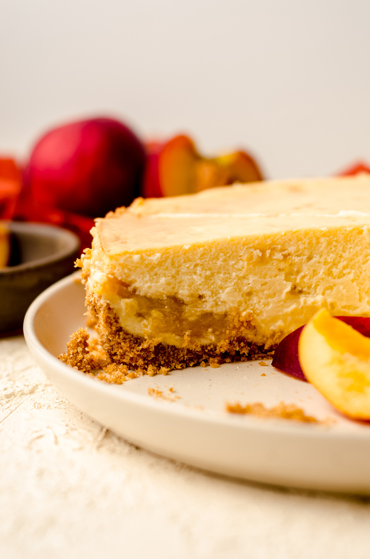 peach cheesecake on a plate