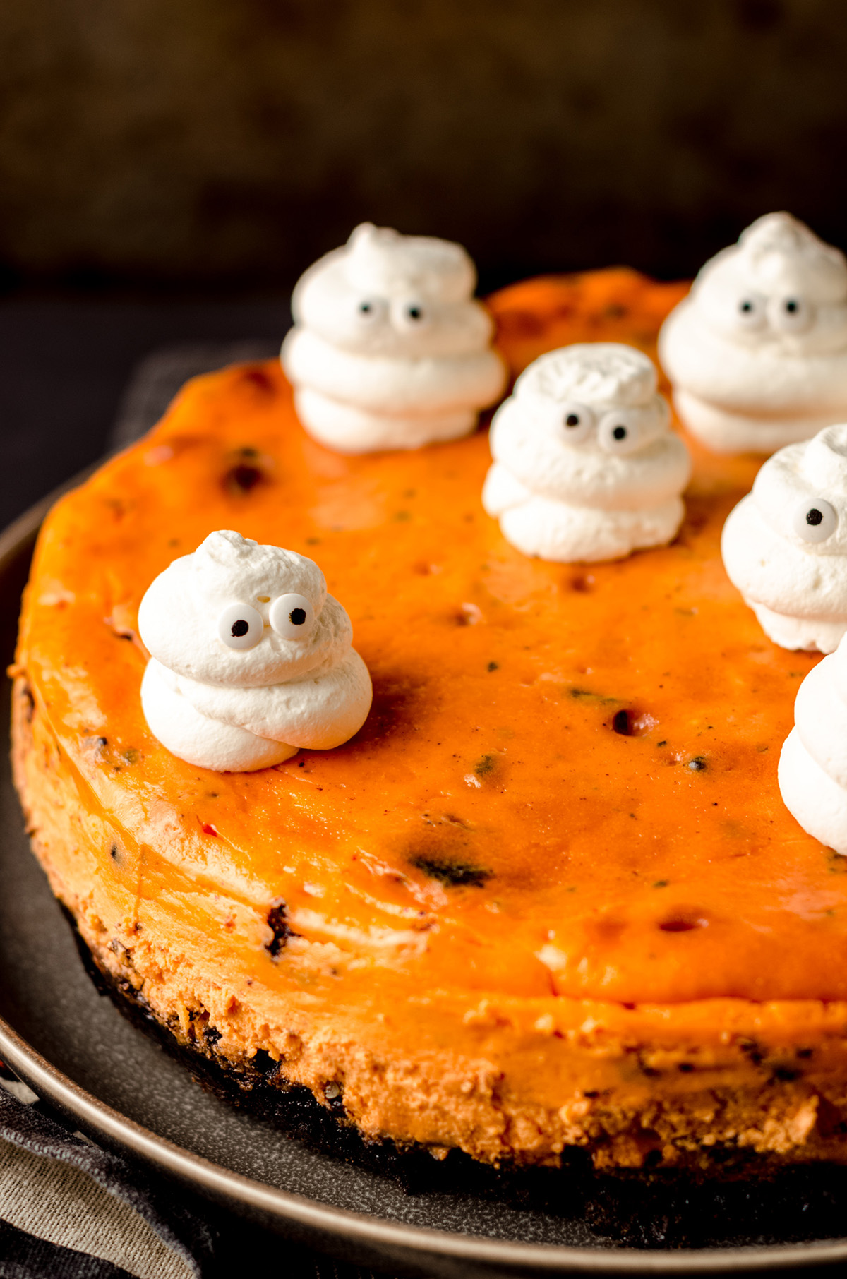 halloween cheesecake with whipped cream ghosts