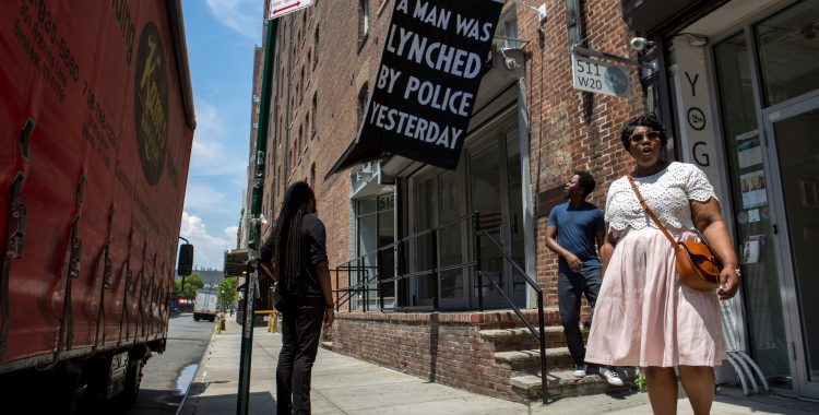 Dread Scott's banner outside Jack Shainman Gallery, New York, 2016. Photo Credit Santiago Mejia/The New York Times