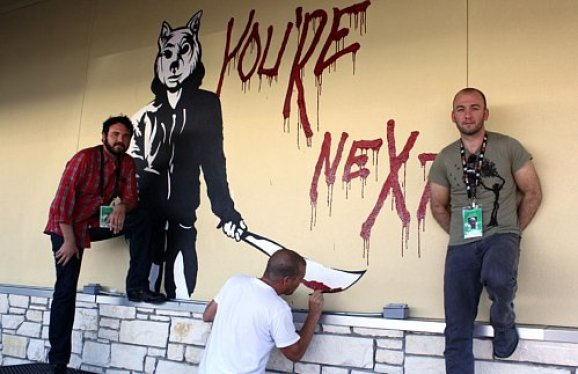 AJ Bowen and Simon Barrett stand in front of the YOU'RE NEXT mural, located behind the Alamo Drafthouse on Lamar.