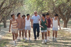 Center, Coach Jim White (Kevin Costner) and his cross country team. Photo courtesy of Walt Disney Pictures.