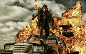 Tom Hardy is a cool guy, walking from an explosion in MAD MAX: FURY ROAD.