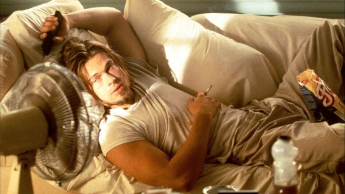 "Brad Pitt Lounging on the couch right before he demands ""More beer and cleaning products"""