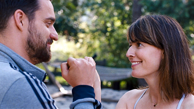 Jake Johnson and Rosemarie DeWitt in DIGGING FOR FIRE. Photo courtesy of The Orchard.