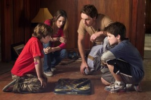 Jonah Bobo, Kristen Stewart, Dax Shepard and Josh Hutcherson star in ZATHURA. Photo courtesy of Columbia Pictures.