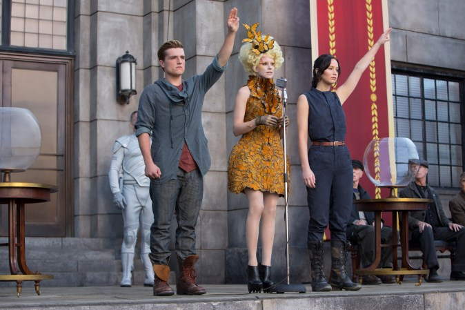 "Josh Hutcherson as Peeta Mellark, from left, Elizabeth Banks as Effie Trinket and Jennifer Lawrence as Katniss Everdeen in a scene from ""The Hunger Games: Catching Fire. (Photo Courtesy of Lionsgate)"