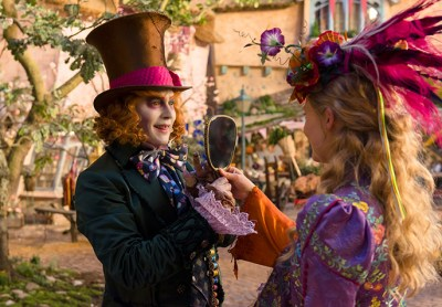 Johnny Depp and Mia Wasikowska return as the Hatter and Alice in ALICE THROUGH THE LOOKING GLASS. Photo courtesy of Disney.