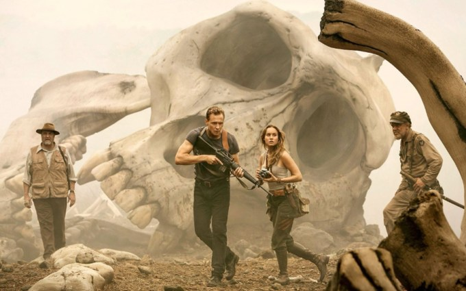 John Goodman, Tom Hiddleston, Brie Larson and John C. Reilly in KONG: SKULL ISLAND. Courtesy of Warner Brothers.