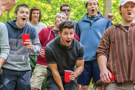 Nick Jonas (center) and his fraternity brothers cheer on the Hell Week festivities (photo courtesy of Paramount)