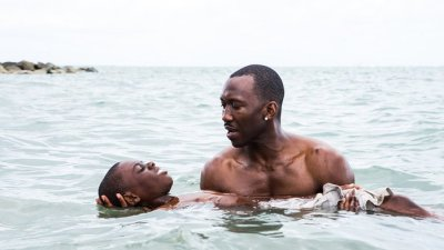 Mahershala Ali's Juan (right) teaches Alex R. Hibbert's Little (left) how to swim. Courtesy of A24.