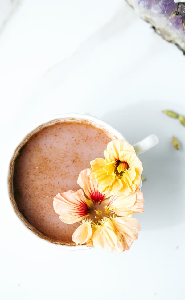 Blueberry Moon Milk will lull you to sleep with delicious and nourishing adaptogens, cardamom, turmeric and ginger. golden milk   turmeric milk   moon milk   adaptogens   adaptogenic herbs   blueberry milk   blueberry milk tea   what are adaptogens   what is ashwagandha   mucuna