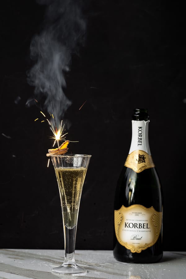 With a simple ginger infused simple syrup on hand it's easy to celebrate (anytime!) with festive cocktails like the Ginger Sparkler! ginger   ginger cocktails   uses for ginger   ginger cocktail syrup   champagne cocktails   new years drink   fresh ginger cocktails