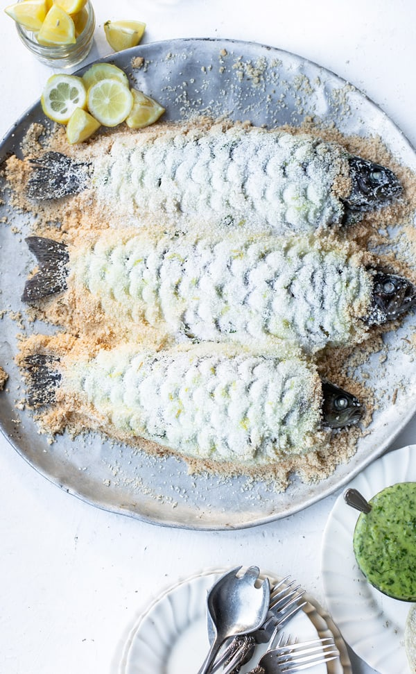 Find yourself with a whole fish and wondering how to cook it? This Salt Baked Fish method honors the beautiful whole fish with an equally stunning and delicious preparation. Baked fish fillets   salt crusted fish   salmon recipe   baked fish with salt crust   #ad @MortonSalt @Safeway