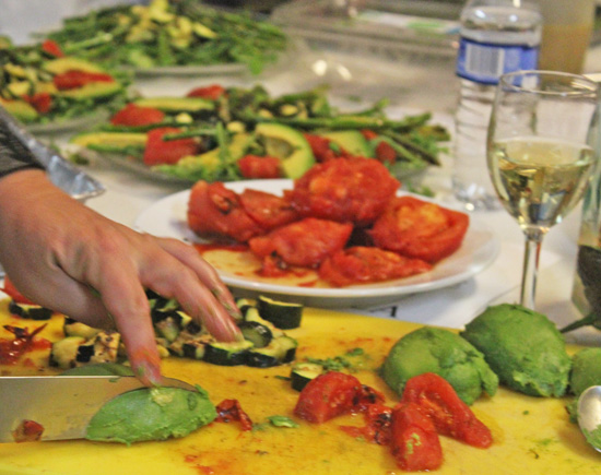 Tracie slices the vegetables while Carolyn artfully plates them.