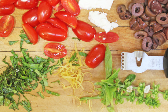 Ingredients prepped for Italian Farro Salad with grape tomatoes, feta and Kalamata olives.