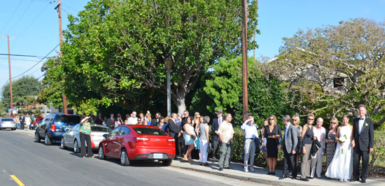 Wedding Guests walk the short block from the church to our home on a picture perfect day! Photo by Mike Gitchell.