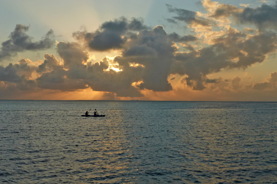 Two of the sailors take a sunset kayak ride.
