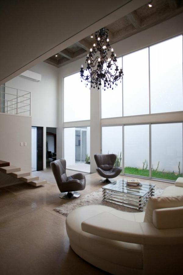 Minimalistisches Haus mit industriellem Touch in Cann Mexiko
