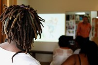 Janelle watching Ewan present his work