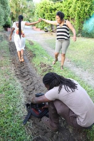 Barbadian filmmaker Sky Larc working with Shea and Sasha