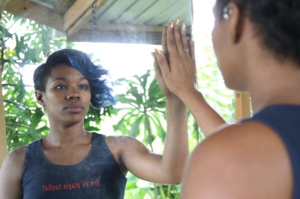 Lead singer of Barbadian band Nexcyx, Mahalia Cummins with Shea Rose