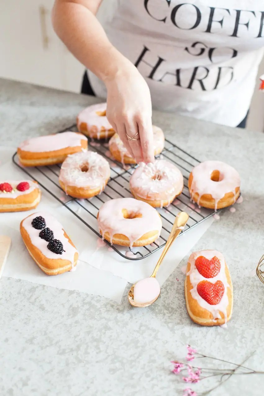 There's definitely no right or wrong way to celebrate with donuts, whether it be a special occasion or a normal day you want to delight in. Invite some friends over or bring out your toppings and let the family have at it to sweeten the deal! Let everyone frost their own DIY pretty in pink donuts and compare toppings before indulging that sweet tooth with every bite!