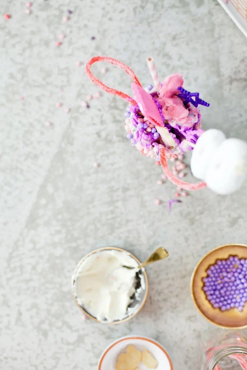 These Epic Royal Crazyshakes are indulgentlyMAGICAL! A rich, thick strawberry milkshake is topped with a sugaringof sprinkles and candies to make a delicious crazy shake drink fit for aprincess... or a prince. A pretty in pink and purple freak shake!