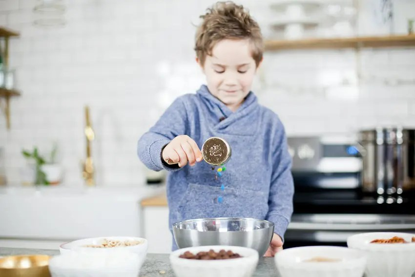 Kid Friendly Trail Mix Puppy Chow Activity and Snack! The kids will love this fun way to build and create their own trail mix, even on a rainy day!