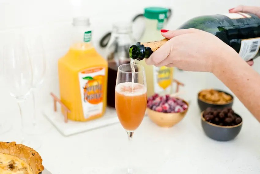 A mimosa bar makes a perfect addition to breakfast or brunch, and makes it easy on the hostess as guests can happily serve themselves. Just a small tweak makes it family-friendly, plus incredibly simple 2-ingredient sparkling sugared cranberries make a beautiful topper – and perfect for holiday snacking or beautiful on desserts!