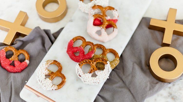 A simple and easy Valentine's Day chocolate dipped pretzels treat, that you can make with and for your kids (they look like they took more effort than they really do!), by Tabitha Blue of Fresh Mommy Blog - Valentines Day Lovely Chocolate Dipped Pretzels by popular Florida lifestyle blogger Fresh Mommy Blog