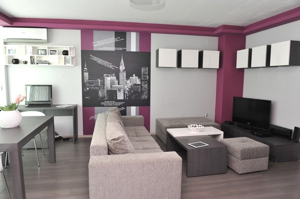 Tiny Apartment In Sofia With Wall Graphic Details This Look Canvas Couch Coffee Table 3 Small